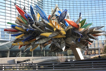 Large sculpture with canoes and other boats