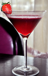 Black Dragon red cocktail with strawberry in a martini glass from Bar Vdara Las Vegas