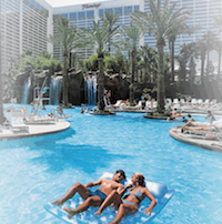 A couple floating on a raft together in the pool at Flamingo Las Vegas