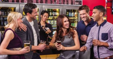 A group of friends drinking beer at TAG Sports Bar in The Linq Las Vegas