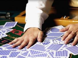 A card dealer's hands mixing up cards at Excalibur Las Vegas