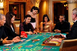 Players gathered around a gaming table at the casino in Caesars Palace Las Vegas