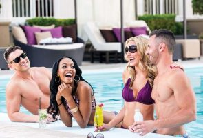 Two couples enjoying Harrah's Las Vegas pool