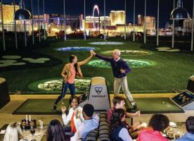 Two people celebrating their great golf swings at Topgolf close to MGM Grand Las Vegas