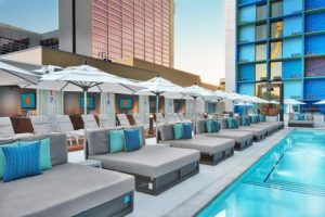 A row of daybeds next to the pool at The Linq Las Vegas