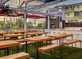 The picnic tables, TV screens, and outdoor patio at Beer Park Beer & Sports Bar at Paris Las Vegas