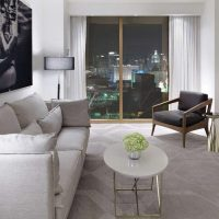 The spacious separate living room of a Scenic Suite in Delano Las Vegas