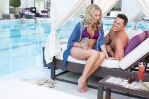 A couple enjoying a poolside experience at Harrah's Las Vegas
