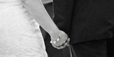 A couple holding hands on their wedding day at The Linq Las Vegas