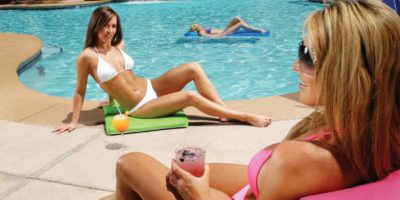 Two women enjoying the sun by the VooDoo Beach at Rio Las Vegas