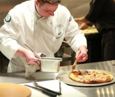 A chef preparing pizza at the Bacchanal Buffet at Caesars Palace Las Vegas