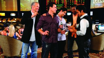 A group of male friends gathered at the Race & Sports Book at Paris Las Vegas